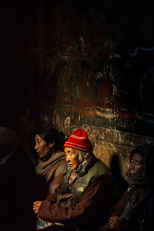 Buddhist women praying at a monastery located in Leh, India.